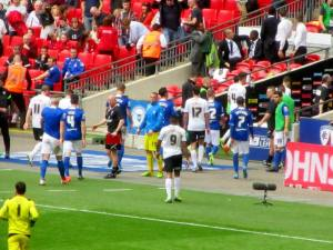 The players head to the dressing rooms