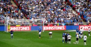 Peterborough line up a free kick