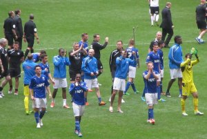 The Chesterfield players applaud the fans