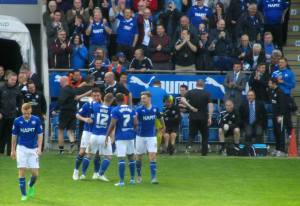 The players celebrate with Roberts