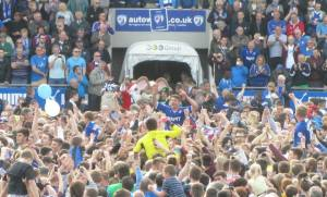 The players are hoisted on the shoulders of the supporters