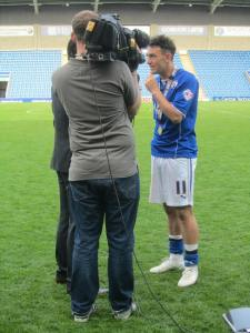 Roberts is interviewed on the pitch