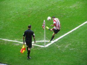Adam Johnson takes a corner
