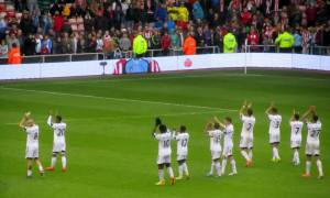 The Swansea players applaud their fans