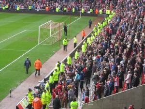 The  Sunderland fans wait for their players