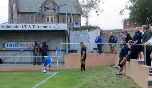Paul Cook looks on as Hallam take a corner