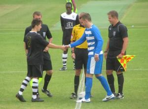 The captains exchange handshakes