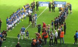 A guard of honour welcomes Leon Osman for his testimonial