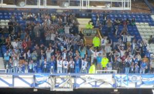The away supporters cheer