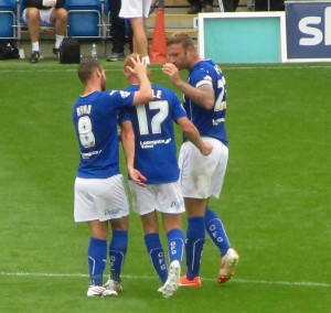Doyle is congratulated as he leaves the field