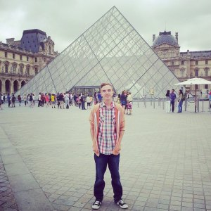 Stood in front of the Louvre Pyramid