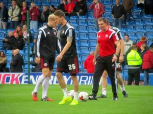 Chris Morgan leads the United warm up
