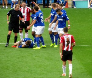 Michael Higdon fouls Daniel Jones...