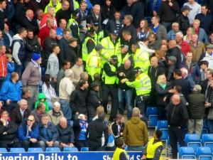 Some United fans in the home end are escorted away