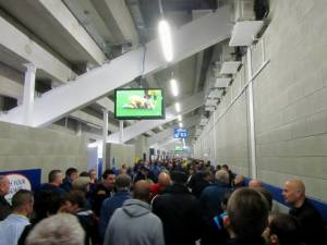 Fans watch the Leeds v Sheffield Wednesday match on TV before the game