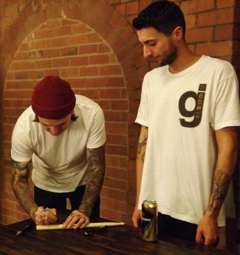 Matt Nicholls signs some drumsticks