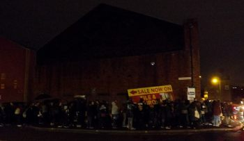 Queuing long in to the night