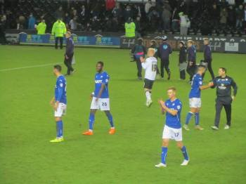 The players applaud the travelling fans