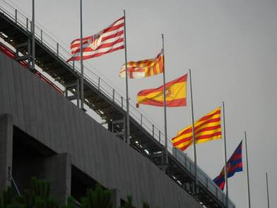 The flags of Barcelona, Bilbao, Spain and Catalonia