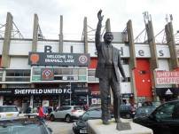 Derek Dooley statue outside the ground