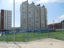 Apartment's tower over the pitch
