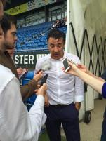 Dean Saunders speaks to the press
