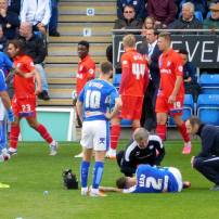 Chris Herd goes down after a late challenge from Bradley Dack