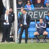Dean Saunders looks on
