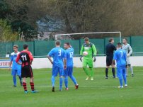 The referee awards Dronfield a penalty