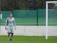 The Rossington goalkeeper furiously shouts at the assistant