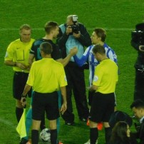 The two captains shake hands