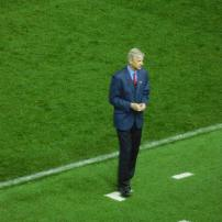 A concerned Wenger looks to his dugout