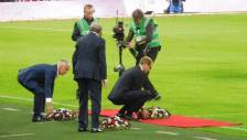 Prince William, France manager Didier Deschamps and England manager Roy Hodgson place flowers at pitchside