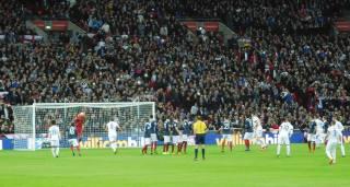 Hugo Lloris meets the free kick