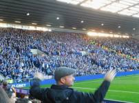 A West Brom fan celebrates in front of the travelling supporters!