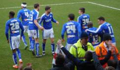 The players and fans celebrate the equaliser
