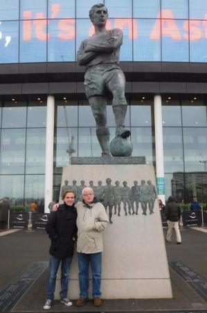 Me and my Grandad by the statue of Bobby Moore