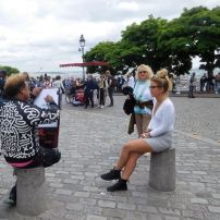 Artists drawing people outside the Sacre Coeur