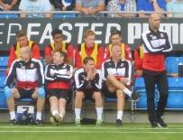 Swindon boss Luke Williams watches on