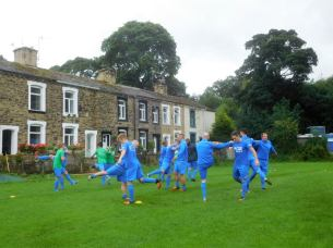 The Nelson players warm up