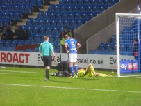 Goalkeeper Chris Neal is forced off through injury early on